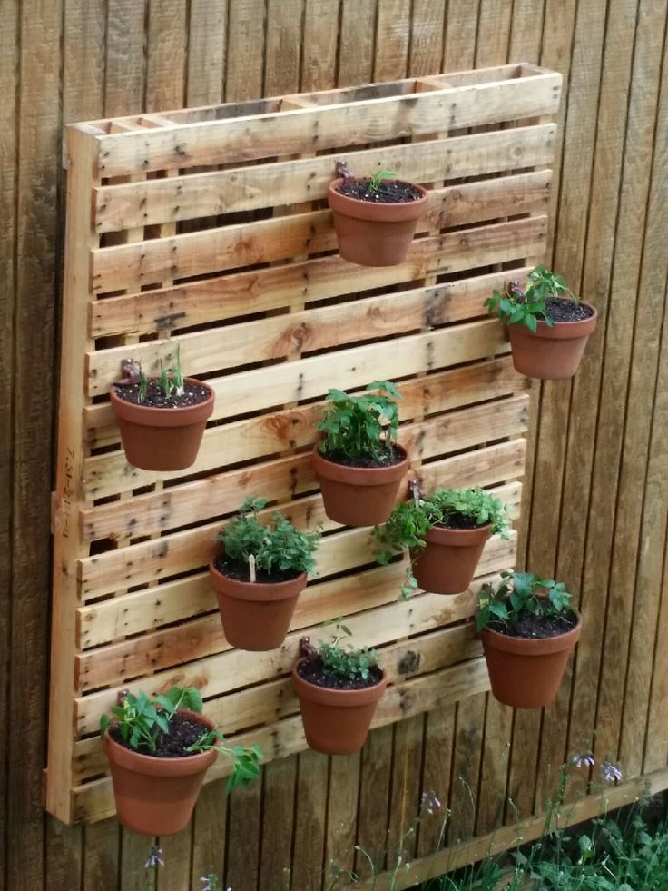 Container Garden Design | Plantscaping | Pallet Garden ... on Hanging Plants Stand Design  id=50117